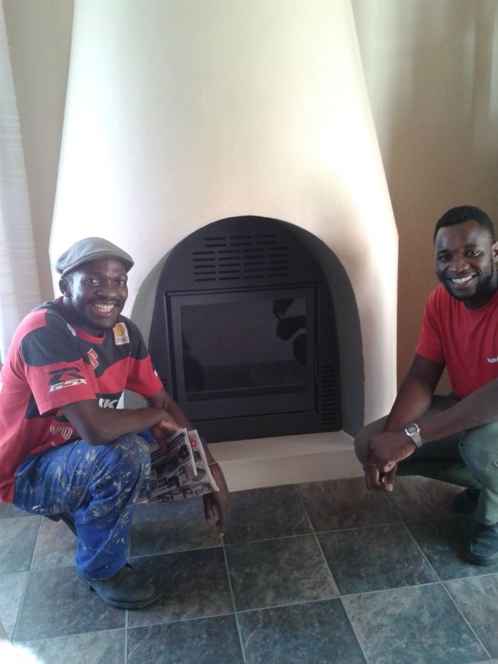 Finished fireplace with the guys who did a very good job